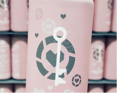 pink can with grey heart and white key logo
